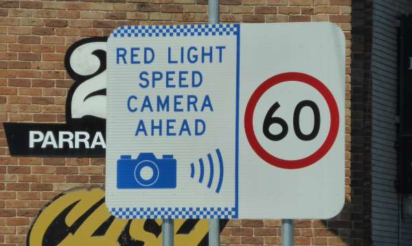 RED LIGHT CAMERA AHEAD SIGN